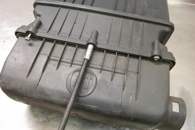 <p>Undo the six 7mm bolts holding the air filter compartment to the rest of the housing,