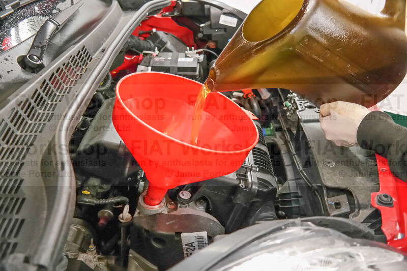 <p>Undo the filler cap and pour in 3 litres of Selenia K Pure Energy oil.