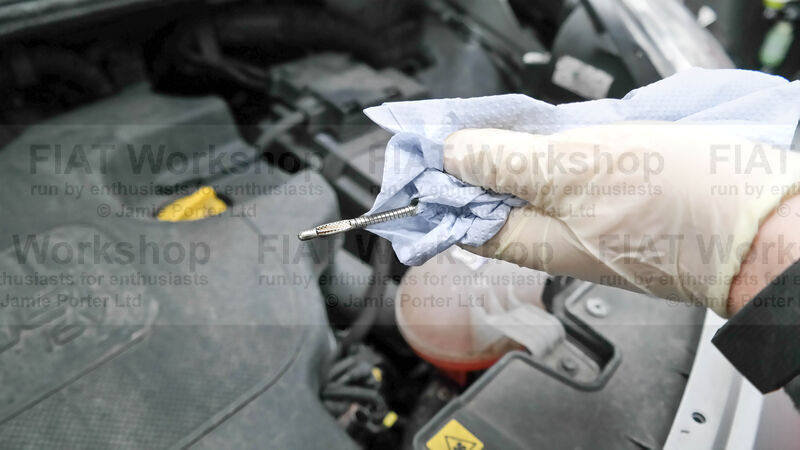 <p>Pull out the dip stick, wipe it, insert it back in then pull it out again. Check the level of oil, if it's too low then top it up and check again.