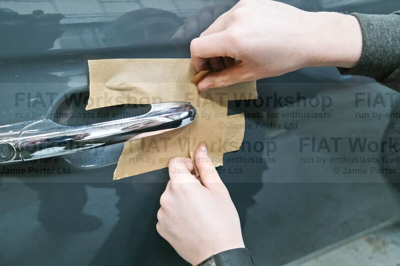 <p>Tape up around the outside door handle to protect the paint work.