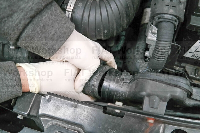 <p>Pull off the hose to the air box and remove the engine cover.