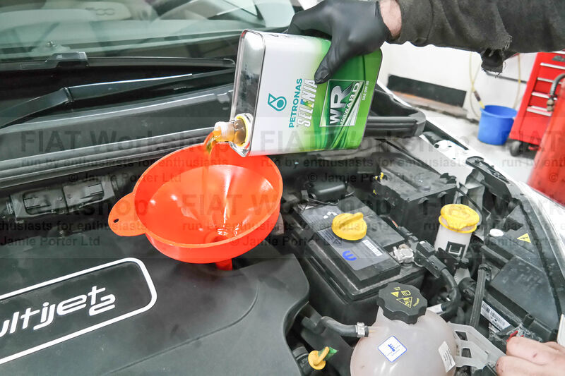 <p>Pour in about x5 litres of the recommended engine oil. Screw the oil filler cap back on then briefly start the engine to circulate the oil.
